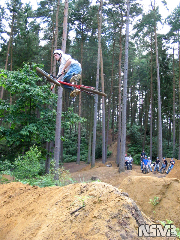 mountain bikers destroy rainforest illegally to build their playground